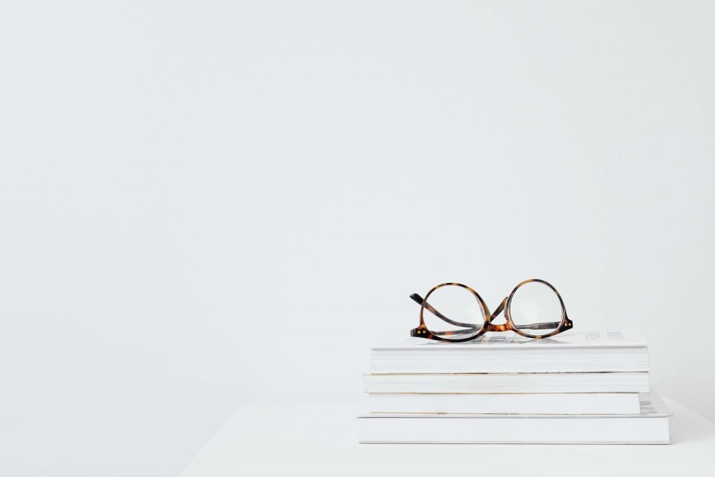 white glasses on table